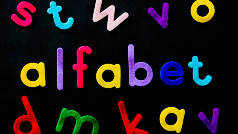 assorted color alfabet letters on black background